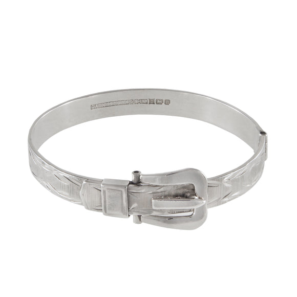 A modern, silver, engraved buckle style bangle
