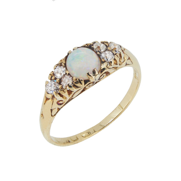 An Edwardian, 18ct yellow gold, opal & diamond set seven stone boat shape ring