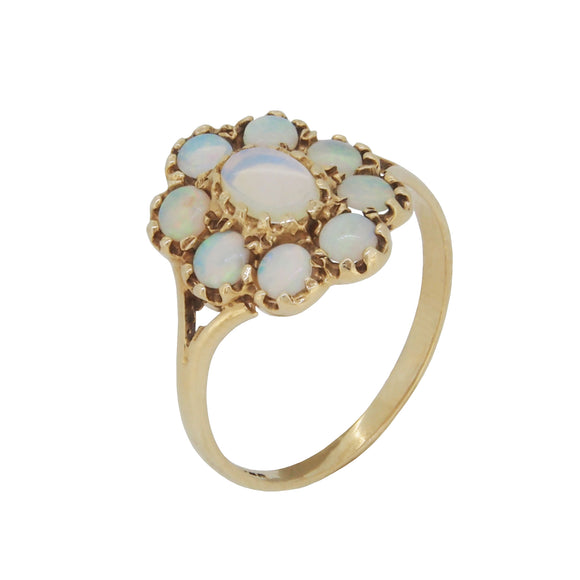 A modern, 9ct yellow gold, opal set, nine stone, oval cluster ring
