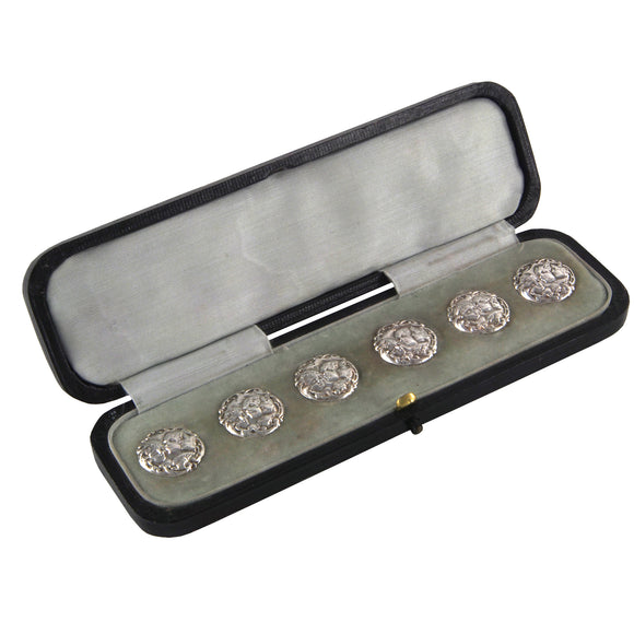 Six Edwardian, silver buttons & fitted case