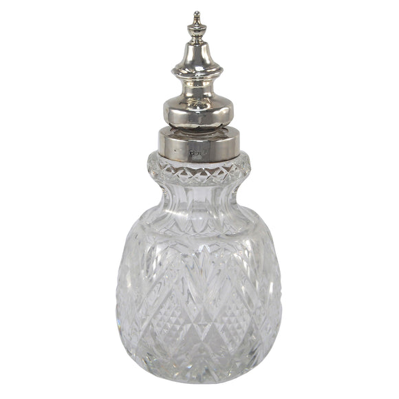 A Victorian, cut glass scent bottle with a silver lid