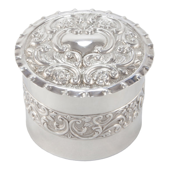 A Victorian, silver, circular, embossed trinket box