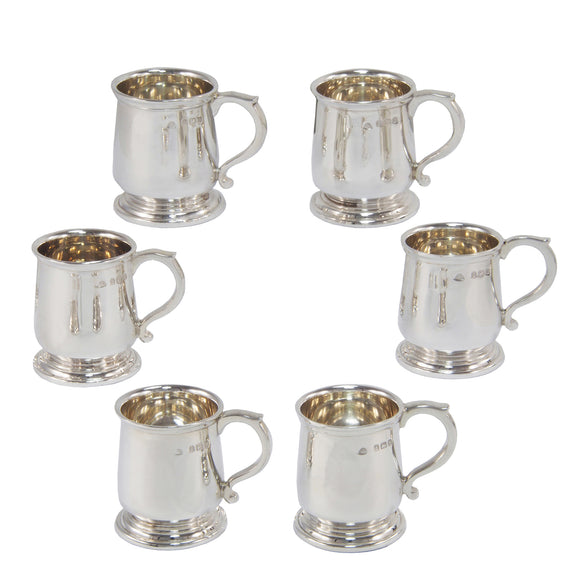 Six early 20th century, silver miniature shot tankards