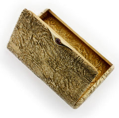 """A Fabergé yellow gold cigarette case with """"samorodok"""" finish by workmaster Henrick Wigstrom, St Petersburg, circa 1910"""