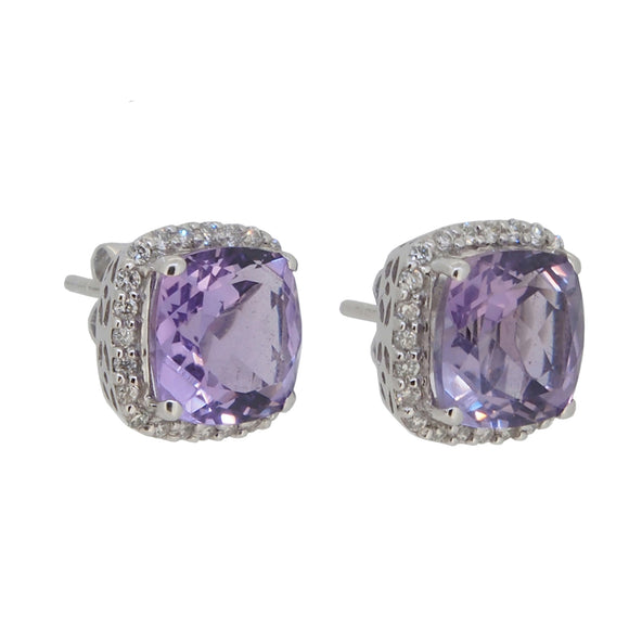 A pair of modern, white gold, amethyst & diamond set cluster stud earrings