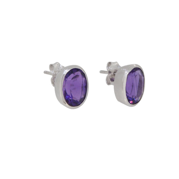 A pair of modern, 9ct white gold, amethyst set oval stud earrings.