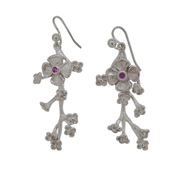 A pair of modern, silver, pink sapphire set, blossom drop earrings