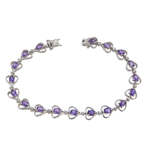 A modern, 18ct white gold, amethyst & diamond set, heart link bracelet.