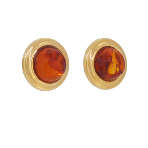 A pair of modern, amber set, circular stud earrings