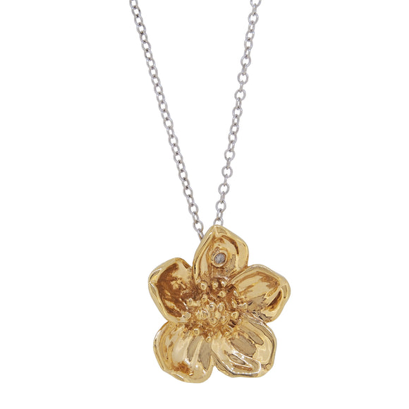A modern, silver & silver gilt, diamond set, flower pendant & chain