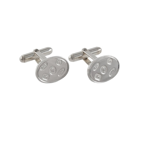 A pair of modern, silver, oval cufflinks with feature hallmarks