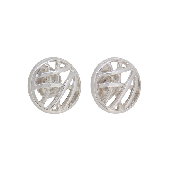 A pair of modern, silver, abstract, circular stud earrings