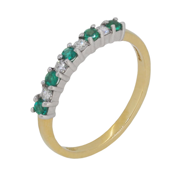 A modern, 18ct yellow gold, emerald & diamond set half eternity ring