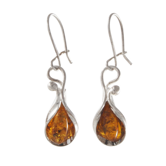 A pair of modern, silver, amber set drop earrings