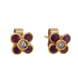A pair of modern, 9ct yellow gold, ruby & diamond set, clover style, cluster stud earrings