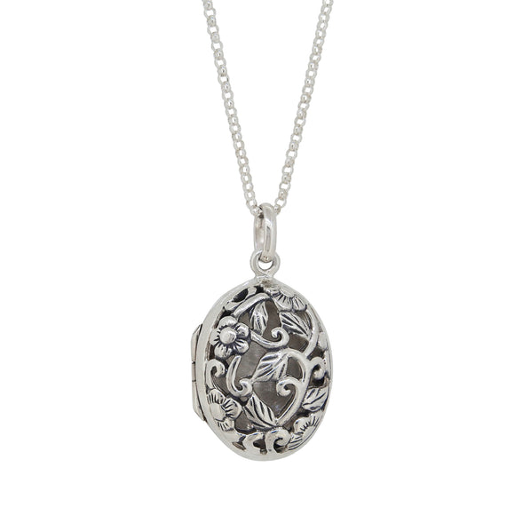 A modern, silver, oval locket with a pierced front & chain
