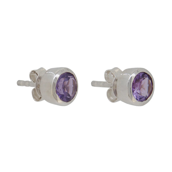 A pair of modern, silver, amethyst set stud earrings