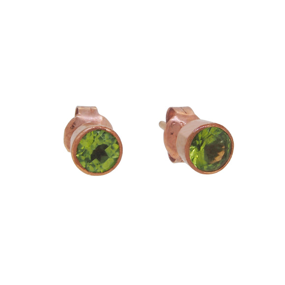 A pair of modern, 9ct rose gold, peridot set stud earrings