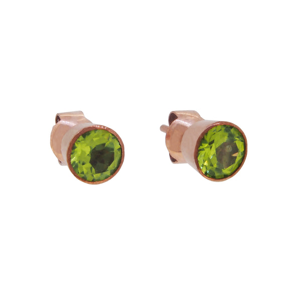 A pair of modern, rose gold, peridot set stud earrings