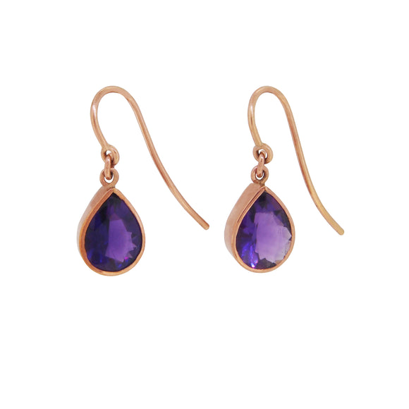 A pair of modern, 9ct rose gold, amethyst set stud earrings