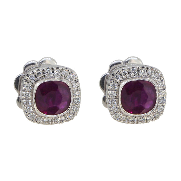 A pair of modern, 18ct white gold, ruby & diamond set, cushion shaped cluster stud earrings
