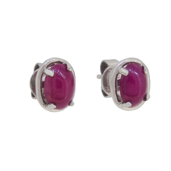 A pair of modern, 9ct white gold, ruby set stud earrings