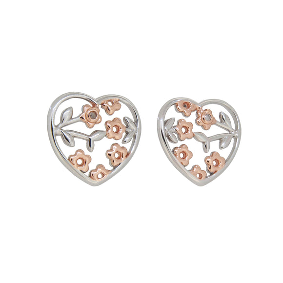 A pair of modern, silver & partial gilt diamond set, open work, heart shaped floral earrings
