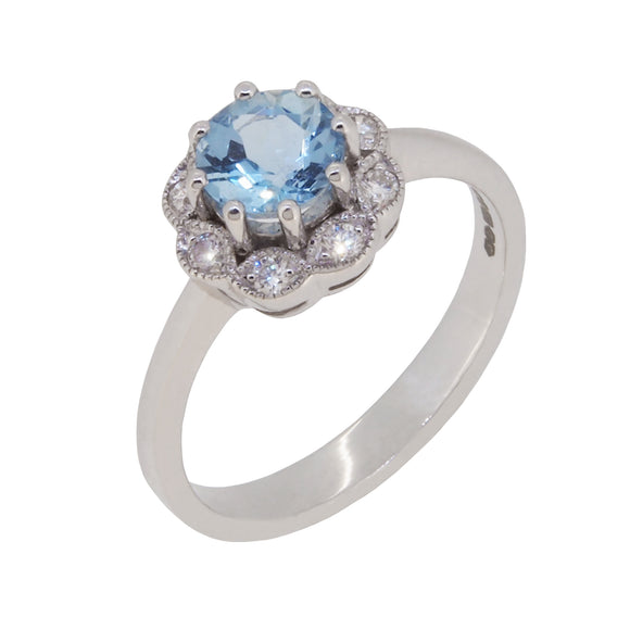 A modern, 18ct white gold, aquamarine & diamond set cluster ring