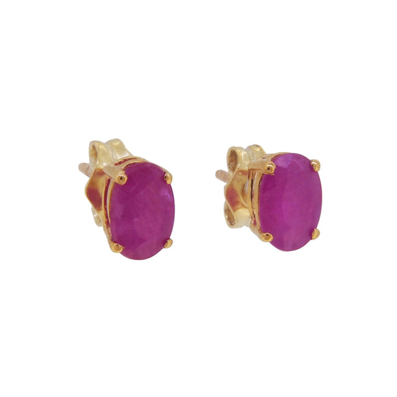 A pair of modern, 9ct yellow gold, ruby set stud earrings