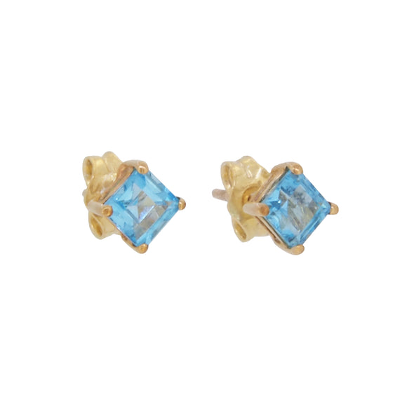 A pair of modern, 9ct yellow gold, blue topaz set stud earrings