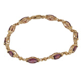 A modern, 9ct yellow gold, rhodolite garnet set bracelet