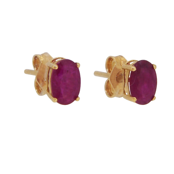 A pair of modern, 18ct yellow gold, ruby set stud earrings