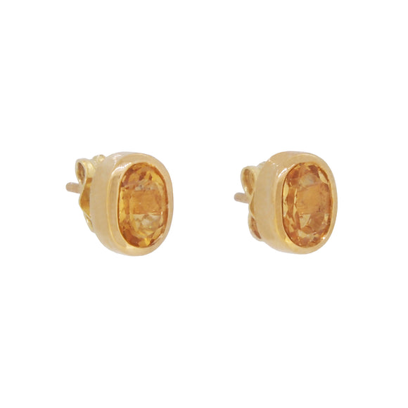 A pair of modern, 9ct yellow gold, citrine set oval stud earrings