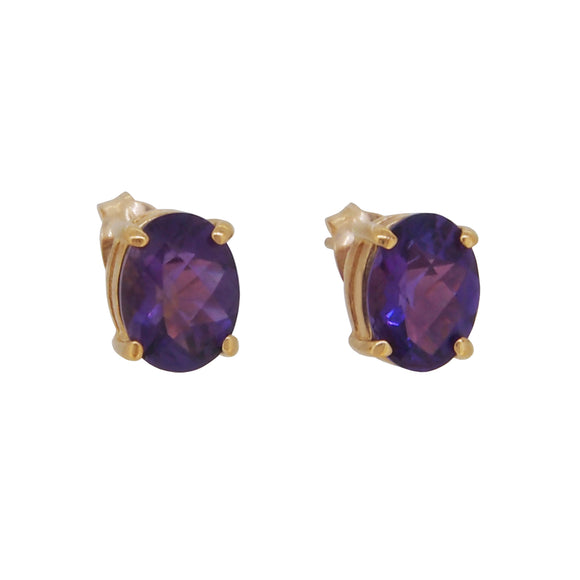 A pair of modern, 9ct yellow gold, amethyst set stud earrings