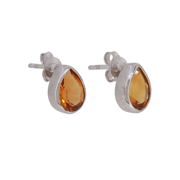 A pair of modern, silver, citrine set stud earrings