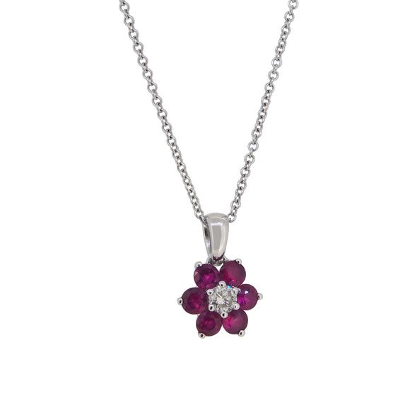 A modern, 18ct white gold, ruby & diamond set cluster pendant & chain.