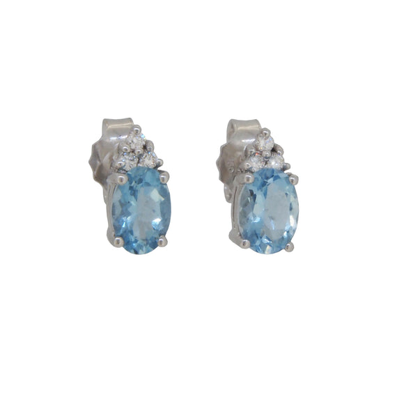A pair of modern, 18ct white gold, aquamarine & diamond set stud earrings