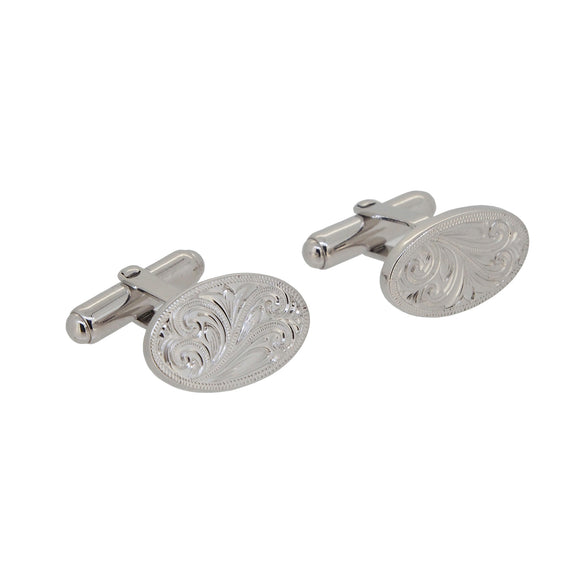 A pair of modern, silver, hand engraved, oval cufflinks