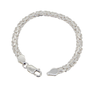 A modern, silver, handmade, abstract, fancy link bracelet