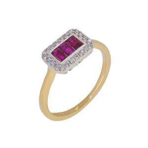 A modern, 18ct yellow gold, ruby & diamond set cluster ring