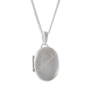 A modern, silver, partially engraved, oval locket & chain