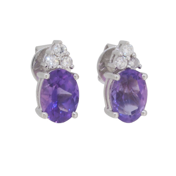 A pair of modern, 18ct white gold, amethyst & diamond set stud earrings