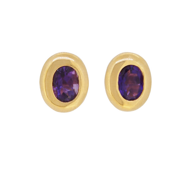 A pair of modern, 18ct yellow gold, amethyst set, oval stud earrings
