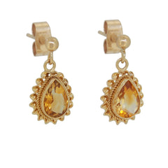 A pair of modern, 9ct yellow gold, citrine set drop earrings with a cord border