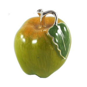 A modern, silver & enamel model of an apple