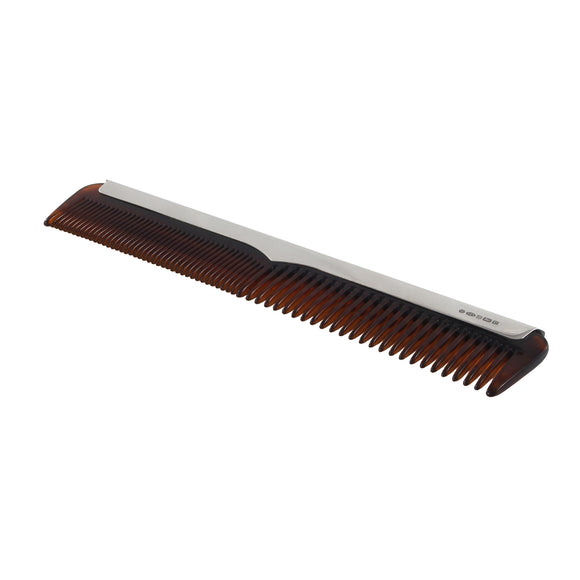 A modern hair comb with a silver mount