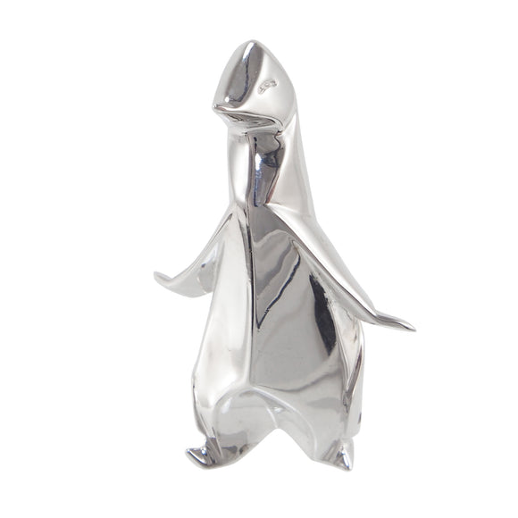 A modern, silver, origami style model of a penguin