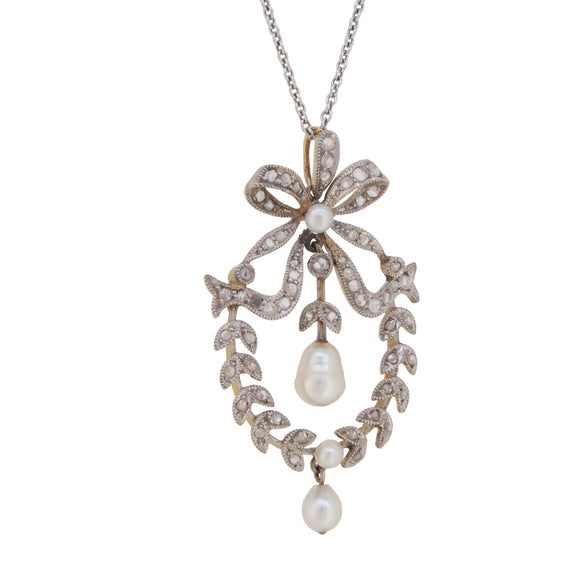 An Edwardian, platinum & yellow gold, diamond & pearl set, laurel & bow pendant & chain
