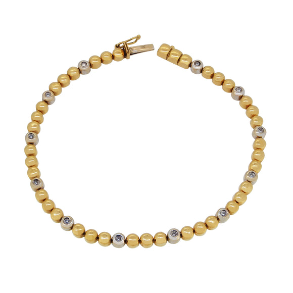 A modern, yellow & white gold, diamond set bracelet