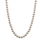 A modern, single row of regular cultured pearls on a pearl set snap